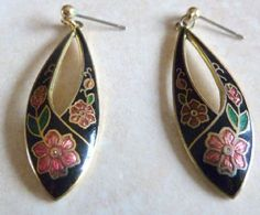 Cloisonne floral drop earrings by Fish and Crown.  Each earring is formed from a stretched black oval, with red floral decoration.  Cut away detailing and 22ct gold plating,  suitable for pierced ears with push backs.  Circa 1980's - 90's. Marked with the Fish and crown symbol to the back.