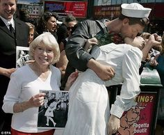 A nurse who was famously photographed being kissed by an American sailor in New York's Times Square in 1945 to celebrate the end of World War Two has died at the age of 91. Her name was Mrs Edith Shine. - The identity of the sailor remains disputed and unresolved, although a man named Carl Muscarello has claimed it was him. - From then on the photograph also made its mark on Shain's life as the fame she garnered led to invites to war related events such a wreath layings, parades and other…