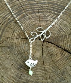 FREE SHIPPING Lariat Bird and Branch Sterling Silver Necklace, Minimalist style,  Bird Jewelry, Bird charm, Leaf Pendant, Wedding jewelry. by Eternity31 on Etsy https://www.etsy.com/listing/161796021/free-shipping-lariat-bird-and-branch