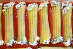 Step by step photos and instructions for How to Make Manicotti - spinach and cheese stuffed manicotti. Recipe, photos and how-to video included.