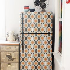 """Use removable wallpaper to snazz up the refrigerator!"" OMG! It's removable!!! I love that idea since I move around every so often!"