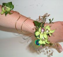 Have bridesmaids wear wrist corsages instead of carrying bouquets. Some ideas.
