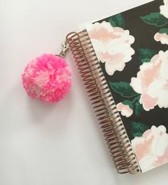 A personal favorite from my Etsy shop https://www.etsy.com/listing/527008009/hot-pink-swirl-pom-pom-keychain-planner