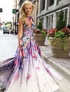 Style 22753 http://www.jovani.com/prom-dresses/printed-floral-ball-gown-22753