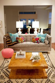 velvet couch, bright pillows, patterned rug. Love it all!!