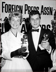 GOLDEN GLOBE WINNERS - Doris Day and Tony Curtis pose with their awards for best actress and actor - Los Angeles - February 26, 1958