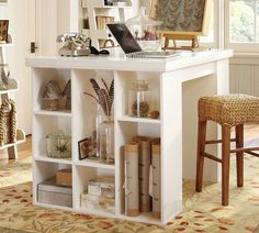 Two book cases on their sides, use drill and wood glue to add smaller shelves, add work surface, and then paint a solid color. Total project can be done under one hundred dollars, Pottery Barn wants a thousand.