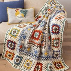 A new take on the classic granny square afghan! The light border sets off the darker center, and the interior border diamonds add a novel twist. Pair with the handsome rooster pillow for perfect farmhouse decor. Crochet with worsted-weight Lion Brand. Crochet Afghans, Annie's Crochet, Crochet Shrug Pattern, Mode Crochet, Granny Square Crochet Pattern, Afghan Crochet Patterns, Crochet Squares, Crochet Home, Crochet Granny