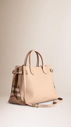 Burberry The Medium Banner in Leather and House Check - A softly structured tote bag in grainy leather and House check cotton. Inspired by equestrian designs, the bag features side buckle fastenings and magnetic press-stud closure, while edges are hand-painted for a clean, graphic finish.