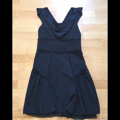 "Zac Posen Crepe Cowl Neck dress. Pics don't do this dress justice!  Lightweight black crepe silk. Wide, cowl neckline. Inverted pleated cap sleeves. Unfinished trim on band at waist. Ruffle trim at hips.  Details: 100% Silk, full lined.  Length: 35"", Waist: 30"".  A size 10 but best fits a U.S. Size 8. Please refer to Zac Posen size chart to confirm your size. Condition: great!  Very little if any signs of wear.    SALES ARE FINAL**.  Please ask questions before making an offer. Zac Posen…"