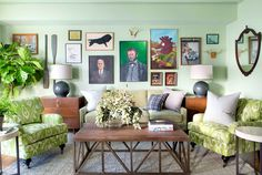 Green living room with gallery wall