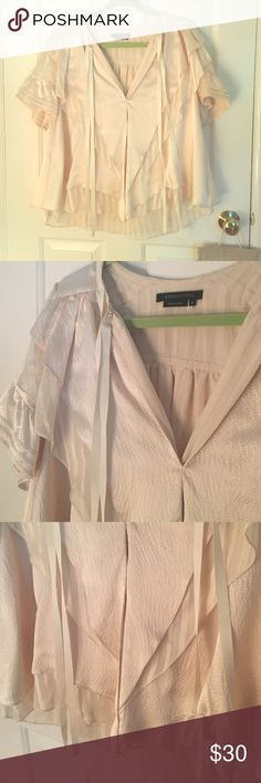 BCBG silk top Stunning and extremely elegant BCBG Max Azria silk layered top. Has ribbon detailing. The color is a combination of a light cream and light pink. Low-cut in the front. Looks extremely sleek with black jeans and pointed heels. Perfect condition. Worn once! Retails for $195! Size small, but runs loose. BCBGMaxAzria Tops Tees - Short Sleeve