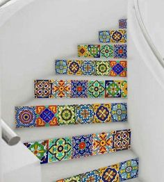 / mexican talavera tile accenting curved stairs / beautiful multi-colors /