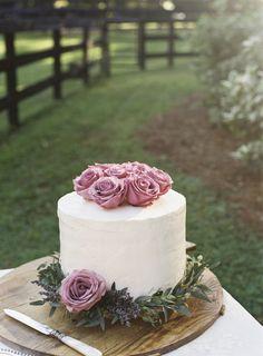 Lavender Garland on Wedding Cake | photography by http://www.ashleyseawellphotography.com/