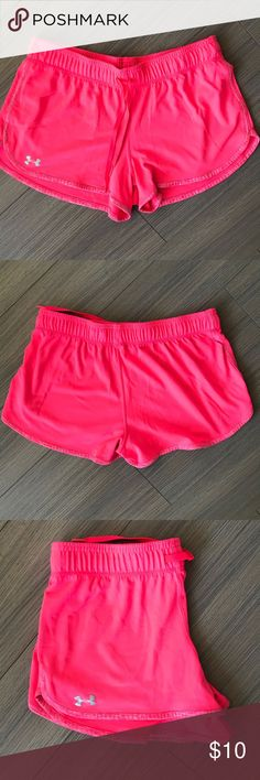 Bright pink Under Armour shorts Loose fitting pink shorts by Under Armour. Super comfortable and pretty vibrant pink color. Great condition Under Armour Shorts