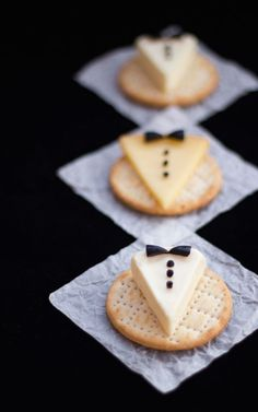 These awe-inducing tuxedo cheese and cracker snacks by Kitchen Mason are perfect for any New Year's party platter. Olive bits provide the bow and buttons on cheese triangles.  Click to see the recipe.