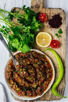 - Turkish Spicy Ezme Salad Served as a sauce on kebabs or as a salsa with some pita, Turkish ezme is a treat nobody can resist. Middle Eastern Dishes, Middle Eastern Recipes, Vegetarian Recipes, Cooking Recipes, Healthy Recipes, Healthy Food, Turkish Salad, Turkish Kebab, Turkish Mezze