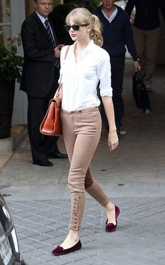 Taylor Swift wearing French Sole FSNY flats, Ray-Ban Original Wayfarer, & a   Mark Cross Scottie Satchel in Cuoio.