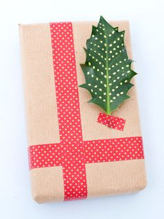 decorate real holly leaves to use as xmas tags / decoration. Great idea!