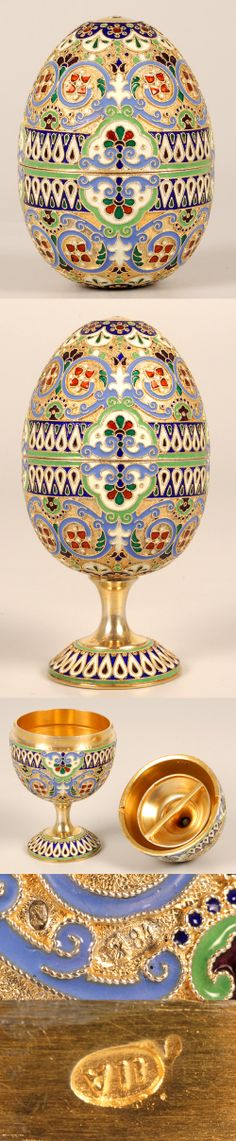 A Russian silver gilt and cloisonne enamel egg, 11th Artel, circa 1908-1917. The two-part egg decorated in a variety of multi-color scrolling foliate and geometric motifs, with enameled fittings for conversion to egg cups.