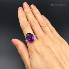 This natural Amethyst ring is a crystallized fairytale dream come true! This purple rain themed beauty will dazzle you with sparkling showers of violet light from it's faceted cabochon.  This oval shaped statement ring is set in sterling silver and has gorgeous deep natural purple color. Amethyst is a February birthstone and this ring is genuine amethyst!