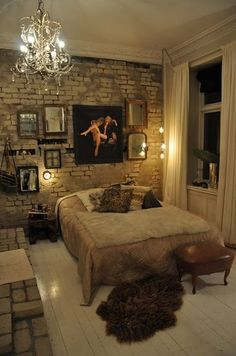 this bedroom is killing me. exposed brick wall, chandelier, cozy bed, white wood floors. just the right amount of vintage feel.