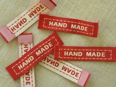 Set of 20  Handmade labels in cream and brick red. Measures approximately 4.5cm x 1cm.   Thank you for looking.