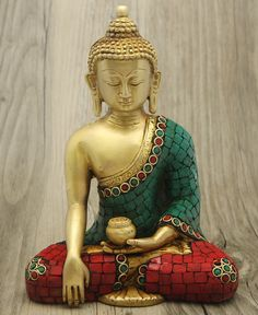 Handmade brass Buddha statue with intricate detailing and colorful accents. Made in India, available at BuddhaGroove.com.