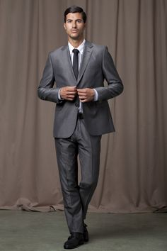 black one bottoned suit with pink shirt and matching