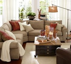 Like table behind L couch.  LOVE this coffee table...useful storage and it's on wheels!!  Can move it when we want to play.  Hope the wheels lock.  Wish it had a soft top for kicking your feet up.  Nice sectional and lamp too.  Pearce 3-Piece L-Shaped Sectional with Wedge - everydaysuede™ | Pottery Barn