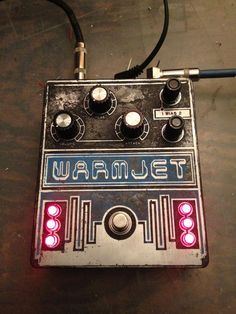 """One-of-a-kind etched Warmjet V fuzz box by Ghost Effects. Based on the WEM Project V fuzz as used by Brian Eno on his album """"Here Come the Warm Jets,"""" especially on the title song. If any stomp box could sound good just by looking good, this one would. Six (!) LEDs, which I believe require a second 9v battery! There aren't any great demos of it, so it's hard to tell if it's worth saving for, but WOW."""