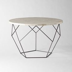 Origami Coffee Table West Elm $399  Look this one up, Laura!  Need 2?