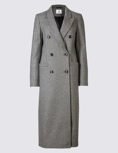 A classic, tailored style, this wool mix overcoat is comfortable and cosy. It's double breasted to enhance the vintage look and looks great dressed up or down. Cut to create a fitted silhouette, choose your normal size.
