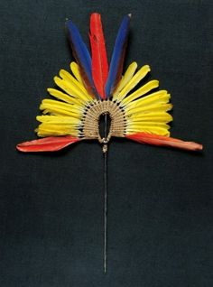 Brazil ~ State of Para | Small crown from the Kayapo Indians Mekrãgnoti | Blue, white and red macaw tail feathers, on a vegetable fiber structure | It is fixed onto a wooden stick for presentation purposes | 900€ ~ Sold