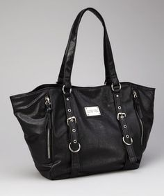 Simply chic, this designer faux leather tote is fashioned with polished silver hardware for an edgy element. The spacious interior features a zippered pocket, two open pockets and a snap closure for secure sorting.