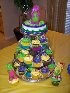 Not sure how to make the semi-creepy Barney for the top, but I like the cupcake tree idea.