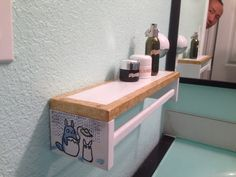 Ikea spice rack hacked into a bathroom towel hanger