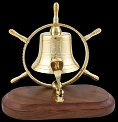 "Solid Brass Recognition Sales Bell. Overall height, on wooden base is 6.5"". Bell is 3"" wide and surrounding metal frame, with brass handles measures 7"" across. Polished brass bell within a solid, nice natural toned finish wooden display base. Press down sharply on the brass striker and ring the bell! Well suited for desks and tables. Ideal for recognition rewards of all sorts from sports to retirements to academics and sales... …"