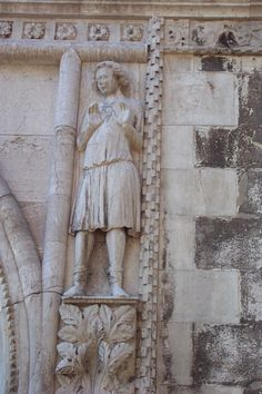 Ham Sculpture -- Doges' Palace, Venice, Italy    The story in Genesis tells us that Ham mocked his father's drunkenness. Noah laid a curse on Ham's son because of Ham's disrespect for him. The bas-relief of Ham is separated from Noah and the other sons by the arch on the building.