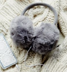 A pair of furry earmuff headphones for the Chanel No. 3 in your life. | 27 Gifts To Make Everyone On Your List A Little Cozier