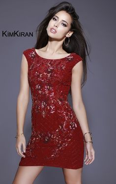 Stand out from the crowd in Kim Kiran 21244. This cocktail dress offers a bateau neckline with cap sleeves and V-open back. Shining beads and sequins are fully showered allover the entire outfit providing glimpses of sparkle all night long.