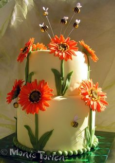 Gerber Daisy Cake With Bees Cake covered with fondant, gerber daisies and bees gumpaste Gerbera Cake, Fondant Flower Cake, Cupcake Cakes, Cupcakes, Fondant Cakes, Daisy Cakes, Bee Cakes, Girl Cakes, Girl Shower Cake