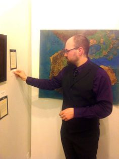 Norwich resident Matthew Cassar, one of three artists featured at city galleries Friday night at this season's initial First Friday event, examines a linotype he created at the Norwich Arts Center.
