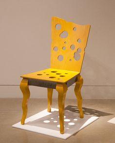 "Mark Hawley Swiss Cheese Chair, 1990 Birch, ash, steel frame 38.5"" x 18.5"" x 16"" $900"