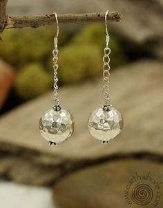 https://earthwhorls.com/collections/earrings/products/1927se  Say it with Silver - always in style.  Handmade, one of a kind, designer jewelry by EarthWhorls.