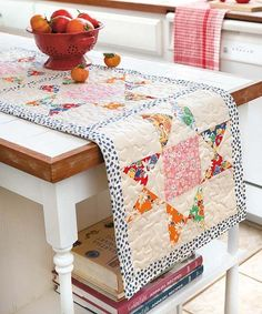 Beautify your home with quick and easy quilted runners for beds and tabletops or hang them on the wall! Some have matching pillow shams and other accessories. Designs by Sue Marsh for Whistlepig Creek Productions include Classic (table runner and place Table Topper Patterns, Quilted Table Toppers, Table Runner And Placemats, Quilted Table Runners, Quilted Table Runner Patterns, Market Table, Homemade Quilts, Bed Runner, Mug Rugs
