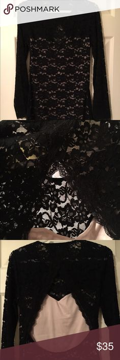 Black Lace Dress with Open Back I wore this to a NYE party and got compliments all night! It hugs your body without being restrictive. It has a cream underlay with black lace on top. At the top of the back, the lace cross crosses at the neck and then goes around at the outside of your back until your booty makes the black lace pop. Very sexy and hits at the knee. Express Dresses Midi