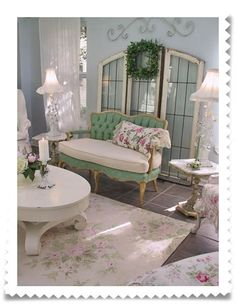 cute mint green loveseat, beautiful shabby chic floral area rug...living room