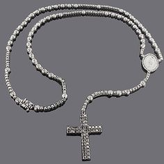 This Black Diamond Rosary Necklace Chain from our custom diamond jewelry collection weighs approximately 76 grams and showcases 31.55 carats of sparkling fancy black diamonds, each expertly prong or bezel set in highly polished gold plated with black rhodium for a unique statement. Featuring an intricate design, an all-black look and a highly polished gold finish with a heavy black rhodium plating, this fabulous black diamond cross chain necklace is a hot ticket item and is fully…