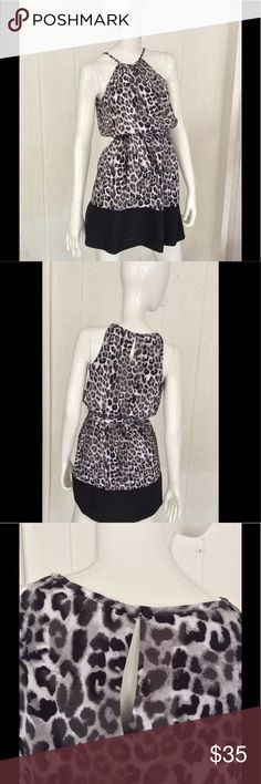 EXPRESS ANIMAL PRINT DRESS SZ XS Beautiful Express animal print dress.  Great little dress that can be dressed up or down! Keyhole button and loop closure and back. Elasticized waist with detachable belt. Perfect used condition.bust measures 17 inches across lying flat, overall length measures 33 1/2 inches. 100% polyester fully washable. Express Dresses